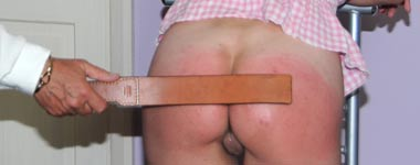 Beaten on her bare bottom
